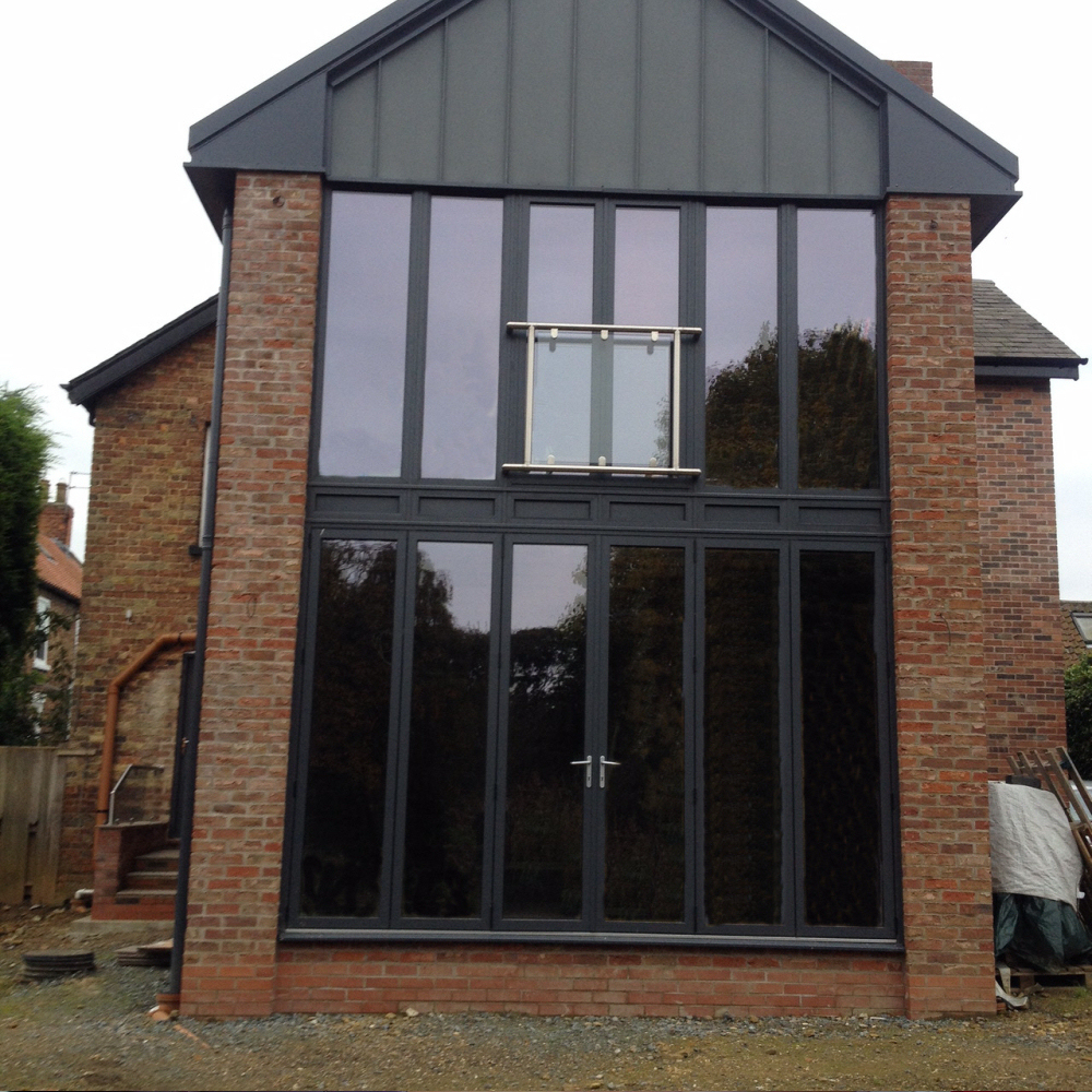 Double height Aluminium Frames With French Doors And Juliet.